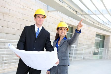 An attractive, diverse man and woman construction team at building site Stock Photo - 5205257