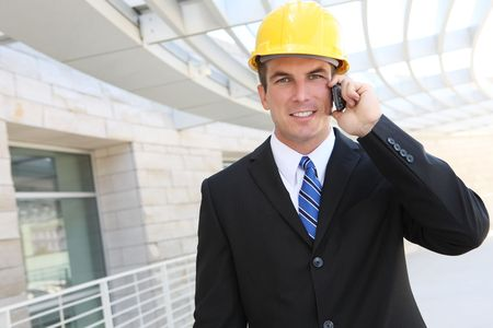 Handsome young Man architect on a building construction site photo