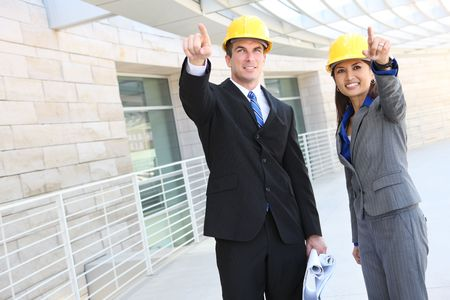 asian architect: An attractive, diverse man and woman construction team at building site