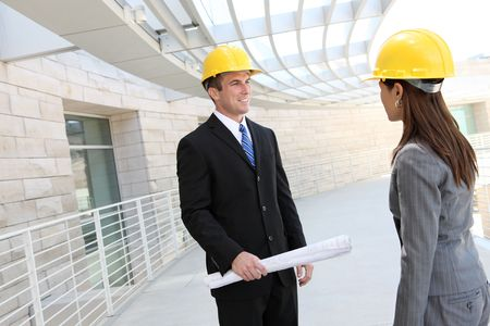asian architect: Attractive diverse man and woman architect team at building site