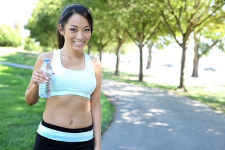 A pretty asian woman exercising in the park photo