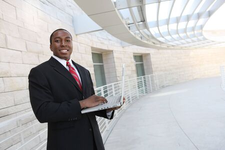 A handsome african business man on laptop computer at office building Stock Photo - 5281334