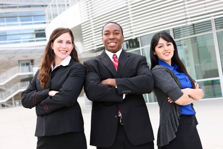 Attractive business man and women team at office building Stock Photo - 5281368