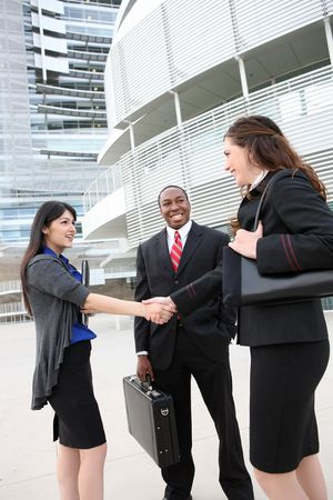 Attractive business man and women team at office building shaking hands photo