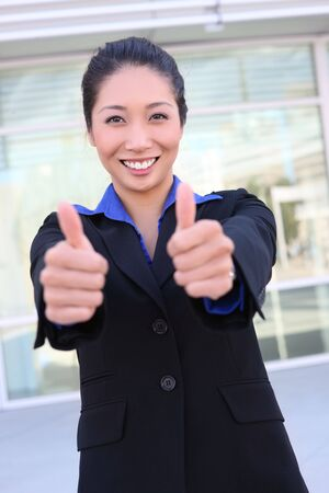 An asian business woman at the office celebrating success Stock Photo - 5314961