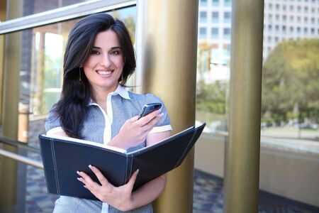 An Indian pretty business woman ouside office on phone Stock Photo - 5353705