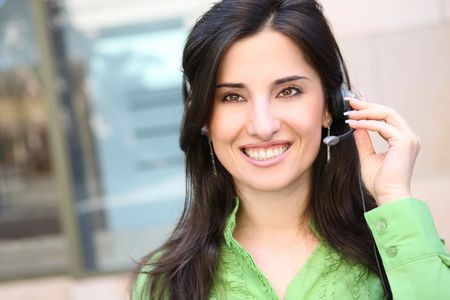 A pretty Indian business woman on phone at office photo