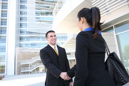 A business man and woman team at office shaking hands photo