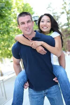 An Attractive man and woman Interracial couple in love  (Focus on Man) photo