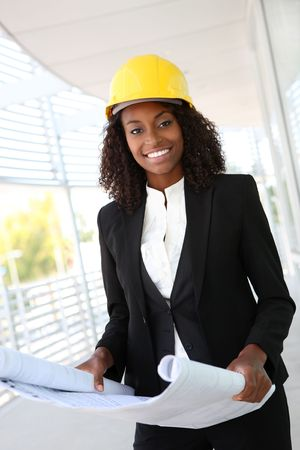 A young pretty woman working as architect on a construction site  photo