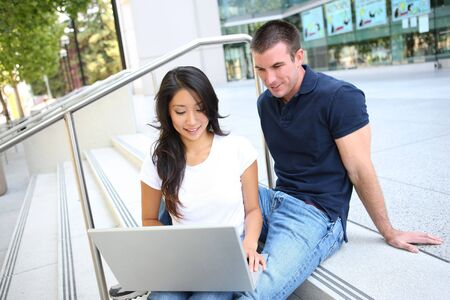 Attractive Man and Woman couple at School Library Stock Photo - 5442301