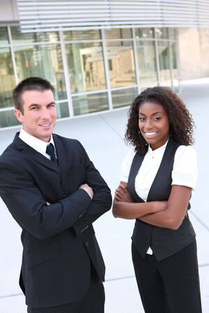 A diverse african and caucasian man and woman business team photo