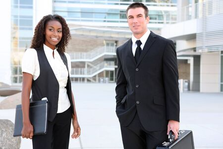 A diverse african and caucasian man and woman business team Stock Photo - 5442304