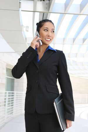 Portrait of smiling consultant woman with phone looking at camera  Stock Photo