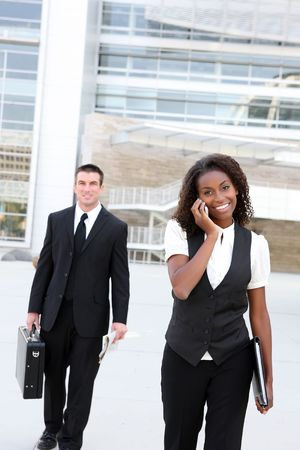 A diverse african and caucasian man and woman business team Stock Photo - 5463064