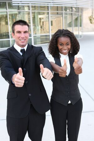A diverse african and caucasian man and woman business team Stock Photo - 5481454