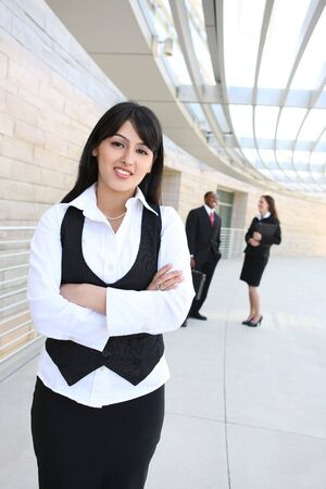 Attractive business men and women at office building photo