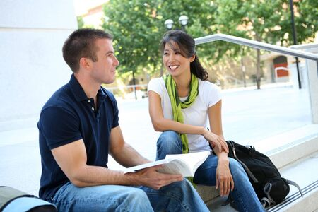 Attractive Man and Woman couple at School Library photo