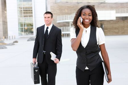A diverse african and caucasian man and woman business team Stock Photo - 5509136