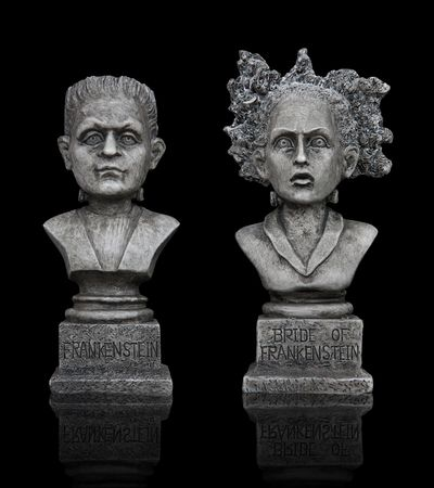 Halloween Frankenstein Statues isolated over black background Banque d'images
