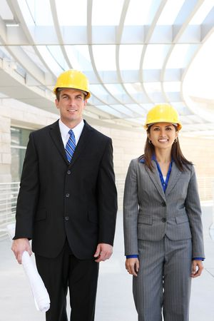 asian architect: A young diverse man and woman construction team at building site