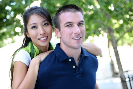 Cute man and woman Interracial couple in love Banco de Imagens - 5509143
