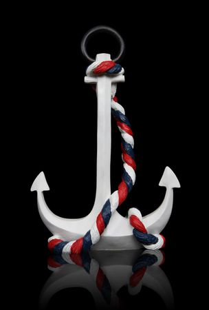 An old  anchor isolated over black background  photo