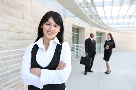 indian business man: Attractive business men and women at office building Stock Photo