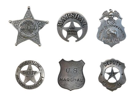 Vintage old sheriff, marshall, amd police badges isolated over white Фото со стока