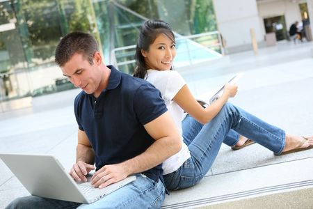 Attractive Teen Man and woman Couple Studying together
