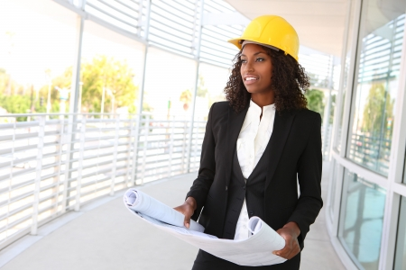 skills diversity: A young pretty woman working as architect on a construction site  Stock Photo