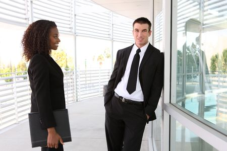 A diverse african and caucasian man and woman business team Stock Photo - 5583893
