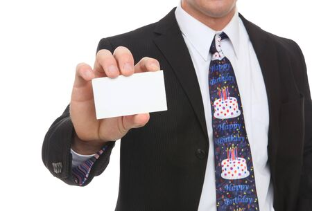 A business man with a happy birthday tie handing card photo