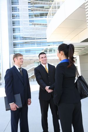 Attractive man and woman business team at the office handshake photo