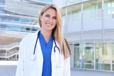 A pretty young blonde woman nurse outside hospital photo