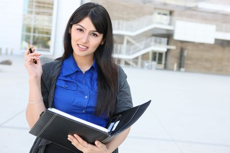 An attractive Indian business woman outside office building photo