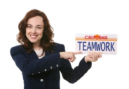 A pretty business woman holding a teamwork license plate Stock Photo - 5736883