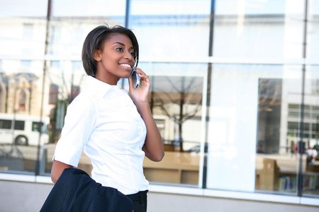 Beautiful african american student woman on the cell phone in front of library Stock Photo - 5791242