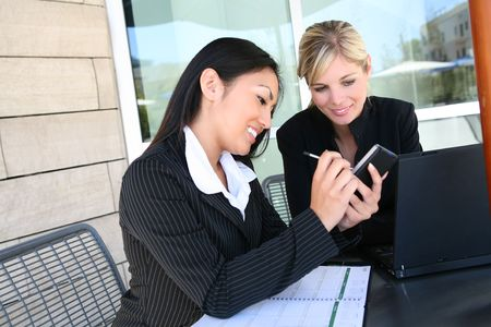 Attractive, young, diverse business woman team at office working Stock Photo - 5813392