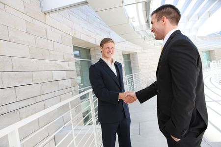 men shaking hands: A business man team at office shaking hands