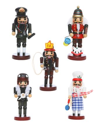 Five colorful wooden toy nutcracker figurines dressed as workers photo