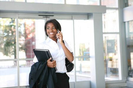 An african american business woman on the cell phone Stock Photo - 5831104