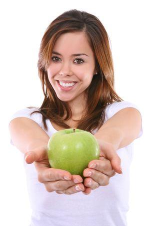 A beautiful young woman handing an apple Stock Photo - 5844802
