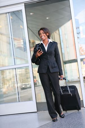 luggage travel: An attractive african american business woman traveling