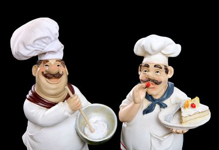 Italian chefs cooking food over a black  background Stock Photo - 5874408