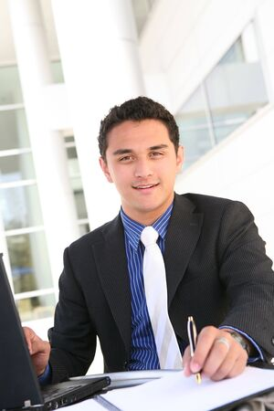 mature mexican: Handsome Latino Business Man at Office Working Stock Photo