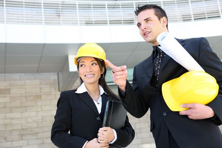 asian architect: A man and woman architect team on  construction site