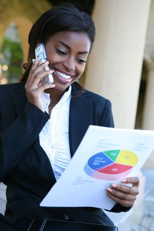 american dessert: Pretty African American Business Woman on the Phone Holding Report