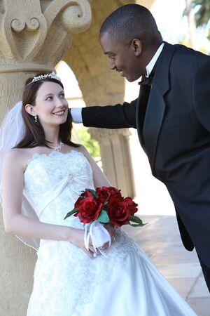An attractive man and woman ethnic wedding couple ready to be married