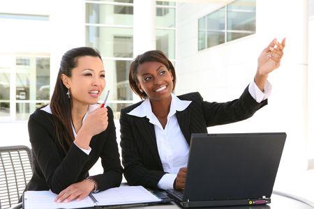 An attractive women business team (Focus on African Woman)